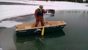 Surveyor in a boat